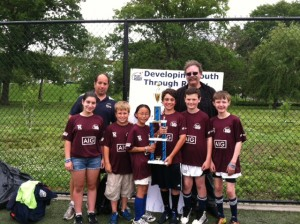 The Pelham elementary flag team and coaches held their trophy for winning the Cup Division.